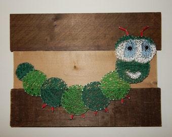 Caterpillar String Art on rustic barn wood wall art