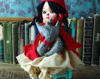 Little red riding hood, original hand made art doll by danita. Has plush wolf that she befriended with her sculpted face and beautiful eyes.