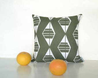 Green linen Scandinavian style pillow cover with a geometric pattern for a modern simple decor.