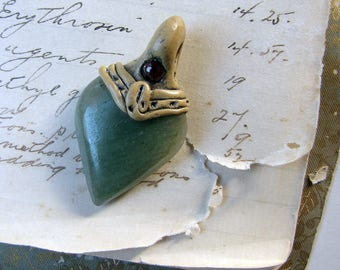 vintage pendant of carved green stone with polymer clay setting