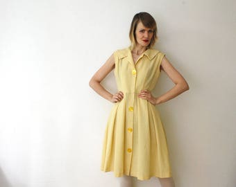 50s dress. pastel yellow shirtwaist dress. pleated dress. knee length dress - medium
