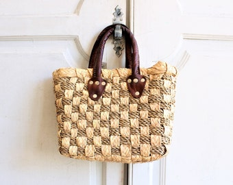 vintage woven basket bag with leather handles