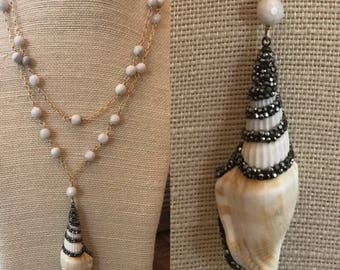 long riverstone necklace with embellished shell pendant