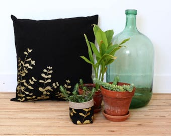 Black linen pillow cover with golden eucalyptus screenprint