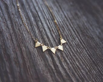 whimsy. a tiny gold plated matte triangle bunting necklace