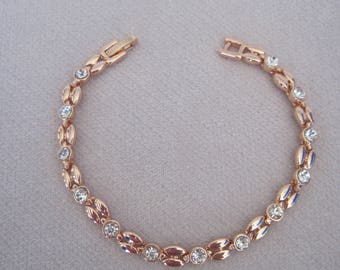 Bevel Set Faceted Crystals with  Paired Almond Shaped Components Chain Bracelet