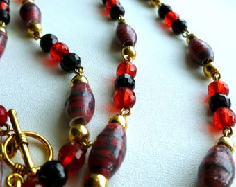 Red and black bead necklace with faceted crystals and handcrafted paper beads