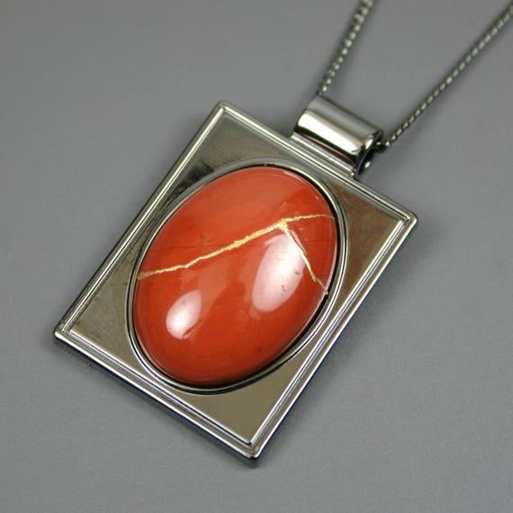 Kintsugi (kintsukuroi) red jasper stone cabochon with gold repair in a rectangular gunmetal plated setting on gunmetal chain - OOAK