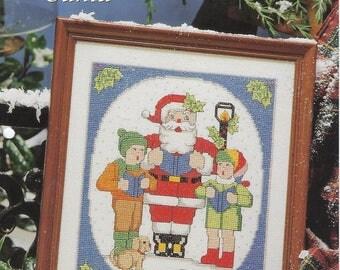 Caroling Santa Cross Stitch Pattern, Christmas Decor, Wall Hanging, Picture, Home Decor, The Needlecraft Shop