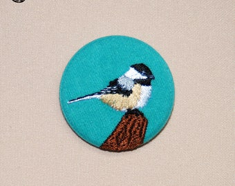 Small brooch, little chickadee recovering