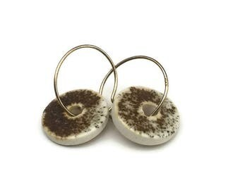 Ceramic hoop earring with a retro rustic brown glaze on a white ceramic bead. TheClayPlay ceramic jewelry with 14k gold plated 925s hoops.