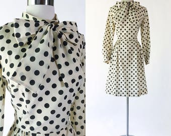 cream & black cotton polka dot print vtg 1960s pinup dress / pussybow / 1960s secretary midi dress / metal zipper / wide skirt