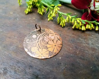 Round 1 inch diameter copper floral patterned pendant