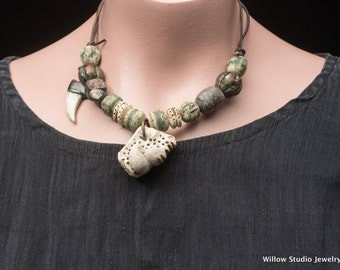 Gris-Gris for the Apocalypse, a rustic ceramic bead necklace with carved pendant of found-bone.  Adjustable from choker to longer.