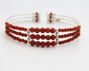 full-bodied coral and silver bracelet