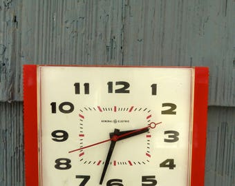 Red plastic electric wall clock by General Electric, fully functioning, red black and white 50s 60s style, Made in USA
