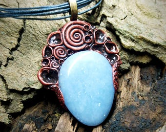 Necklace with Angelite gemstone and tribal spiral symbols