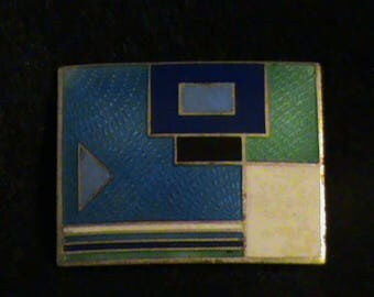 Enameled pin with abstract design