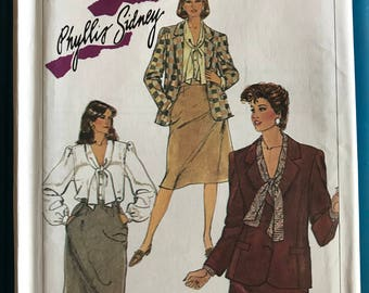 Simplicity 7054 - 1980s Phyllis Sidney Notched Collar Jacket, Bow Tie Blouse, and Knee Length Skirt - Size 24.5 Bust 47