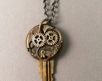 A steampunk themed pendant with gears, key, mechanism, industrial steampunk, necklace with chain included, cosplay, one of a kind, handmade