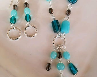 Long teal glass bead necklace and earrings