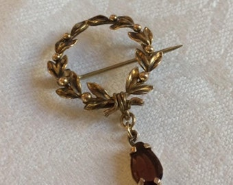 Gold Wreath-of-Leaves Pin with Hanging Garnet