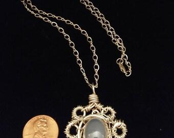 Moonstone cabochin wire wrap Pendant