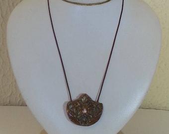 Ceramic and zirconia necklace.