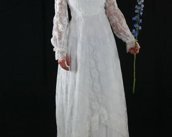 Lace wedding dress with poet sleeves and cathedral train