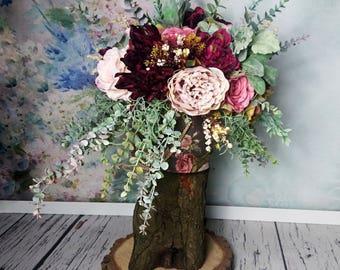 Vintage style floral arrangement boho wedding burgundy blush pink roses eucalyptus wild flowing asymmetrical for pedestal aisle decor fall