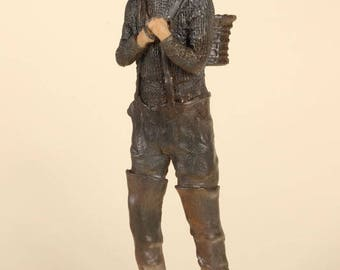 Fisherman with basket resin sculpture
