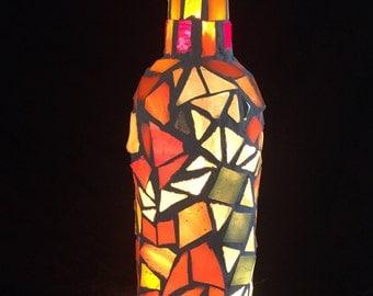 Orange and green lizard mosaic light from repurposed wine bottle
