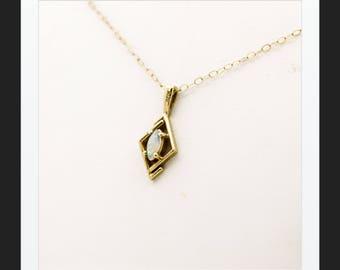 A Pretty Delicate Opal Pendant And Chain   SKU1143
