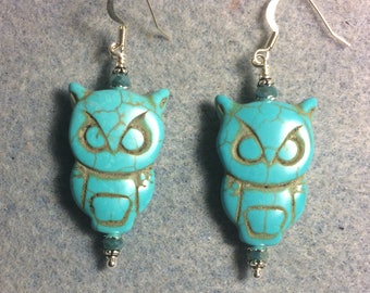Large turquoise howlite gemstone owl bead earrings adorned with turquoise Chinese crystal beads.