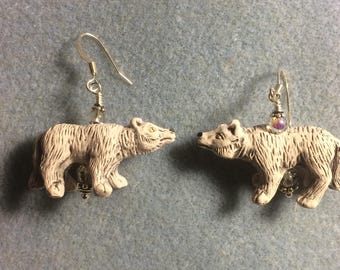 Off white ceramic snarling wolf bead dangle earrings adorned with grey Czech glass beads.