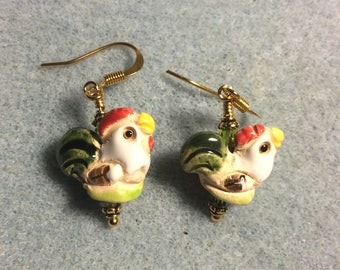 Small olive green, red, and yellow ceramic chicken bead earrings adorned with olive green Chinese crystal beads.