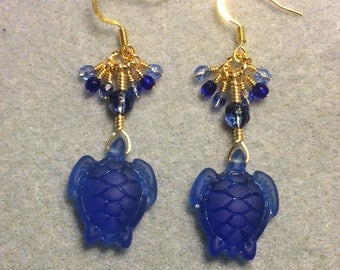 Dark blue sea glass sea turtle bead earrings adoned with dark blue Czech glass beads and tiny dangling blue Czech glass beads.