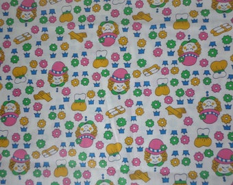 Girls fabric Girls head wearing hats shoes glooves purses and lots of flowers pastel colors 1 yard by 44 inches wide.