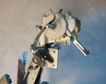 Bird sculpture from scrap typewriter parts