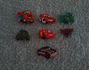 Lot 5 jibbitz Cars (badges for fangs)
