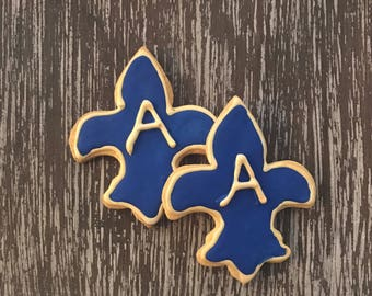 Monogrammed fleur de lis royal blue and gold sugar cookies for birthday parties or other special events, sports team cookies, cookies