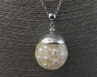 Bubble pendant beads: resin and fine white freshwater pearls, steel necklace.