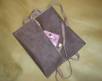 In shades of brown suede pouch
