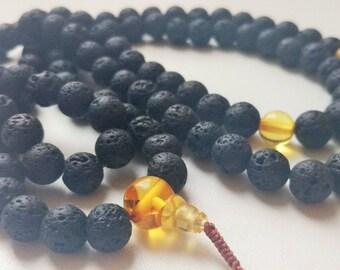NOIR - 108 lava stone & baltic amber mala for meditation (size Ø8.6)