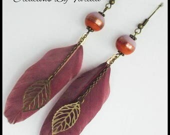 Earrings with a purple feather, a leaf and a lovely two-tone purple and orange bead