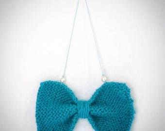 To hang as you like turquoise knit bow