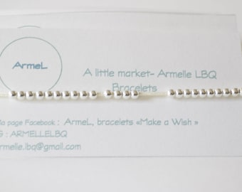off-white adjustable cord bracelet and 925 Silver beads