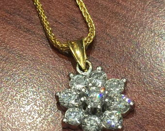 An Impressive Flower Shaped Diamond Pendant on a matching 18K Yellow Gold Italian Chain.