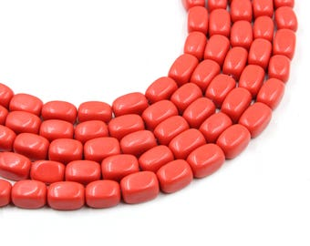 "12-13mm faceted coral barrel beads in red 15"" strand"