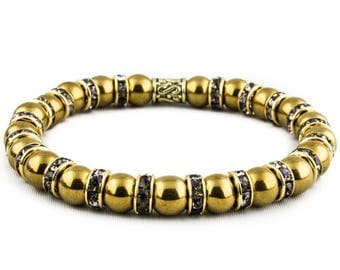 The Midas Touch: Gold Hematite Stone & Grey Crystal Spacers